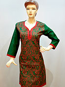 Simple captivating cotton kurti is nicely designed with traditional woman face patterned embroidery on all over done with dhaga. Fabric lace border work on neckline, border and sleeves. It's a casual and formal wear drape. Slight Color variations are possible due to differing screen and photograph resolutions.