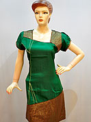 A Simple plain green cotton kurti has a strips patterned fabric patch on neckline and border. It gives a different look everywere. Color combination of this kurti is nice. It's a casual wear drape. Slight Color variations are possible due to differing screen and photograph resolutions.