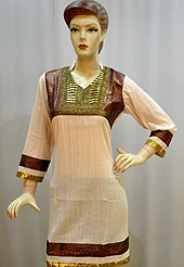 Stylish and simple cotton kurti is nicely designed with shimmer fabric patch work on neckline and border. This kurti gives you a smart and trendy look and make different to others. Color of this kurti is peach. It's a daily wear drape. Slight Color variations are possible due to differing screen and photograph resolutions.