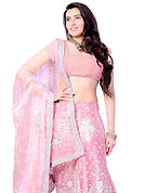 Get ready to sizzle all around you by sparkling lehenga. This pink net A-Line lehenga choli is nicely embroidered and patch work done with stone, sequins, beads and cutdana work in form of floral motifs. Beautiful hand embroidery work on lehenga is stunning. The beautiful embroidery on lehenga made it awesome and gives you stylish and attractive look to others. Matching faux georgette choli and net dupatta is availble with this lehenga. Slight Color variations are possible due to differing screen and photograph resolutions.