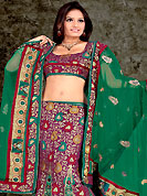 Take a look on the changing fashion of the season. This maroon and green lehenga choli is nicely floral, paisley print, embroidered and patch work done with  resham, sequins and stone work in form of floral motifs. All over embroidery work on lehenga is stunning. The beautiful embroidery on lehenga made it awesome and gives you stylish and attractive look to others. Matching and dupatta is availble with this lehenga. Slight Color variations are possible due to differing screen and photograph resolutions.