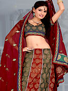 Get ready to sizzle all around you by sparkling lehenga. This maroon and deep green lehenga choli is nicely embroidered and patch work done with  resham, zari and sequins work in form of floral motifs. Beautiful embroidery work on lehenga is stunning. The beautiful embroidery on lehenga made it awesome and gives you stylish and attractive look to others. Matching and dupatta is availble with this lehenga. Slight Color variations are possible due to differing screen and photograph resolutions.