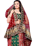 Take a look on the changing fashion of the season. This maroon and green net and dupion silk A-Line lehenga choli is nicely embroidered and patch work done with resham, zari and sequins work in form of floral motifs. All over embroidery work on lehenga is stunning. The beautiful embroidery on lehenga made it awesome and gives you stylish and attractive look to others. Matching choli and dupatta is availble with this lehenga. Slight Color variations are possible due to differing screen and photograph resolutions.
