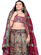 Elegance and innovation of designs crafted for you. This deep burgundy net and dupion silk A-Line lehenga choli is nicely embroidered and patch work done with resham, zari and sequins work in form of floral motifs. All over embroidery work on lehenga is stunning. The beautiful embroidery on lehenga made it awesome and gives you stylish and attractive look to others. Matching choli and dupatta is availble with this lehenga. Slight Color variations are possible due to differing screen and photograph resolutions.