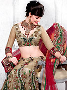 Take a look on the changing fashion of the season. This dark beige and red net lehenga choli is nicely embroidered and patch work done with resham, sequins, applique and stone work in form of floral and paisley motifs. All over embroidery work on lehenga is stunning. The beautiful embroidery on lehenga made it awesome and gives you stylish and attractive look to others. Matching choli and red net dupatta is availble with this lehenga. Slight Color variations are possible due to differing screen and photograph resolutions.
