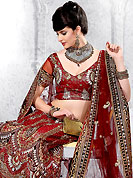 Today's fashion is really about sensuality which can be seen in this creation. This maroon net lehenga choli is nicely embroidered and patch work done with resham, zari and stone work in form of floral and paisley motifs. All over embroidery work on lehenga is stunning. The beautiful embroidery on lehenga made it awesome and gives you stylish and attractive look to others. Matching choli and dupatta is availble with this lehenga. Slight Color variations are possible due to differing screen and photograph resolutions.
