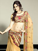It's cool and has a very modern look to impress all. This light fawn faux georgette lehenga choli is nicely embroidered patch work done with resham, sequins, stone and beads work in form of floral motifs. The beautiful embroidery on lehenga made it awesome and gives you stylish and attractive look to others. Matching choli and dupatta is availble with this lehenga. Choli can be customized upto 42 inches. Slight Color variations are possible due to differing screen and photograph resolutions.