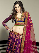 Embroidered lehengas are highly in order on a range of occasions such as wedding, formal party and festivals. This deep purple net lehenga choli is nicely embroidered patch work done with resham, zari, sequins, stone and beads work in form of floral motifs. The beautiful embroidery on lehenga made it awesome and gives you stylish and attractive look to others. Contrasting dark blue choli and deep pink net dupatta is availble with this lehenga. Choli can be customized upto 42 inches. Slight Color variations are possible due to differing screen and photograph resolutions.