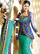 Today's fashion is really about sensuality which can be seen in this creation. This blue and sea green net jacket style lehenga choli is nicely embroidered and velvet patch border is done with resham, zari, sequins and stone work. The beautiful embroidery on lehenga made it awesome and gives you stylish and attractive look to others. Matching choli, dupatta and contrasting blue net jacket is availble with this lehenga. Slight Color variations are possible due to differing screen and photograph resolutions.