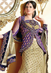 Make your collection more attractive and charming with this impressive dress. This fawn and dark purple net jacket style lehenga choli is nicely embroidered and velvet patch border is done with resham, zari, sequins and stone work. The beautiful embroidery on lehenga made it awesome and gives you stylish and attractive look to others. Matching choli, dupatta and contrasting dark purple net jacket is availble with this lehenga. Slight Color variations are possible due to differing screen and photograph resolutions.