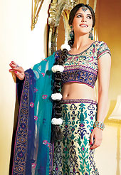 Let your personality speak for you this bridal lehenga embellished with embroidery work. This cream net A-Line lehenga choli is nicely embroidered and velvet patch border is done with resham, zari, sequins and stone work. The beautiful embroidery on lehenga made it awesome and gives you stylish and attractive look to others. Matching net choli and shaded blue net dupatta is availble with this lehenga. Slight Color variations are possible due to differing screen and photograph resolutions.