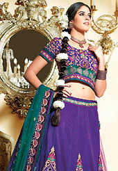 Embroidered lehengas are highly in order on a range of occasions such as wedding, formal party and festivals. This dark purple net lehenga choli is nicely embroidered and velvet patch border is done with zari, sequins and stone work. The beautiful embroidery on lehenga made it awesome and gives you stylish and attractive look to others. Matching net choli and contrasting teal green net dupatta is availble with this lehenga. Slight Color variations are possible due to differing screen and photograph resolutions.