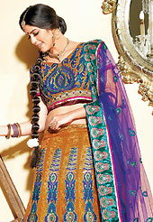 Make your collection more attractive and charming with this impressive dress. This rust and purple net lehenga choli is nicely embroidered and velvet patch border is done with resham, zari, sequins and stone work. The beautiful embroidery on lehenga made it awesome and gives you stylish and attractive look to others. Matching jacquard and net choli and purple net dupatta is availble with this lehenga. Slight Color variations are possible due to differing screen and photograph resolutions.