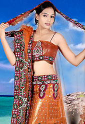 Elegance and innovation of designs crafted for you. This orange net lehenga choli is nicely embroidered patch work done with  resham, sequins and lace work. Embroidery work on lehenga is stunning. The beautiful embroidery on lehenga made it awesome and gives you stylish and attractive look to others. Matching choli and dupatta is availble with this lehenga. Slight Color variations are possible due to differing screen and photograph resolutions.