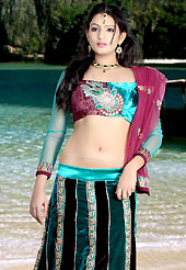 Today's fashion is really about sensuality which can be seen in this creation. This dark teal blue and deep burgundy velvet lehenga choli is nicely embroidered patch work done with  resham, sequins and lace work. Embroidery work on lehenga is stunning. The beautiful embroidery on lehenga made it awesome and gives you stylish and attractive look to others. Matching choli and dupatta is availble with this lehenga. Slight Color variations are possible due to differing screen and photograph resolutions.