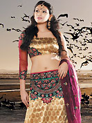 It's cool and has a very modern look to impress all. This beige and brown brocade lehenga choli is nicely embroidered patch work done with  resham and sequins work in form of floral motifs. Embroidery work on lehenga is stunning. The beautiful embroidery on lehenga made it awesome and gives you stylish and attractive look to others. Matching choli and dark pink net dupatta is availble with this lehenga. Slight Color variations are possible due to differing screen and photograph resolutions.