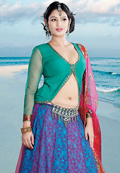 Get ready to sizzle all around you by sparkling lehenga. This blue and dark pink net lehenga choli is nicely embroidered patch work done with  resham, zari, sequins and lace work in form of floral motifs. Embroidery work on lehenga is stunning. The beautiful embroidery on lehenga made it awesome and gives you stylish and attractive look to others. Contrasting turquoise green choli and dark pink net dupatta is availble with this lehenga. Slight Color variations are possible due to differing screen and photograph resolutions.