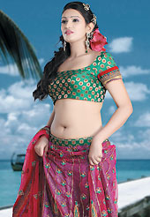 Embroidered lehengas are highly in order on a range of occasions such as wedding, formal party and festivals. This deep pink net lehenga choli is nicely embroidered patch work done with  resham, sequins and lace work. Embroidery work on lehenga is stunning. The beautiful embroidery on lehenga made it awesome and gives you stylish and attractive look to others. Contrasting green and fawn choli and dupatta is availble with this lehenga. Slight Color variations are possible due to differing screen and photograph resolutions.