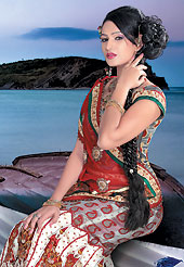 Get ready to sizzle all around you by sparkling lehenga. This off white and red net and satin lehenga choli is nicely embroidered patch work done with  resham, sequins and lace work. Embroidery work on lehenga is stunning. The beautiful embroidery on lehenga made it awesome and gives you stylish and attractive look to others. Contrasting grey choli and red dupatta is availble with this lehenga. Slight Color variations are possible due to differing screen and photograph resolutions.