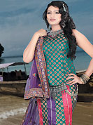 Today's fashion is really about sensuality which can be seen in this creation. This teal green, purple and dark pink brocade and chiffon lehenga choli is nicely embroidered patch work done with  resham, sequins and lace work. Embroidery work on lehenga is stunning. The beautiful embroidery on lehenga made it awesome and gives you stylish and attractive look to others. Matching choli and purple dupatta is availble with this lehenga. Slight Color variations are possible due to differing screen and photograph resolutions.