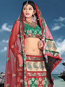 Make your collection more attractive and charming with this impressive dress. This green and red brocade lehenga choli is nicely embroidered patch work done with  resham, sequins and lace work. Embroidery work on lehenga is stunning. The beautiful embroidery on lehenga made it awesome and gives you stylish and attractive look to others. Matching choli and dupatta is availble with this lehenga. Slight Color variations are possible due to differing screen and photograph resolutions.