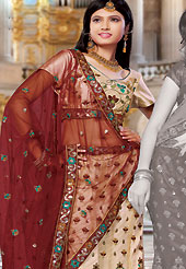 Embroidered lehengas are highly in order on a range of occasions such as wedding, formal party and festivals. This beige net lehenga choli is nicely embroidered and patch work done with resham and sequins work in form of floral motifs. The beautiful embroidery on lehenga made it awesome and gives you stylish and attractive look to others. Matching choli and maroon net dupatta is availble with this lehenga. Slight Color variations are possible due to differing screen and photograph resolutions.