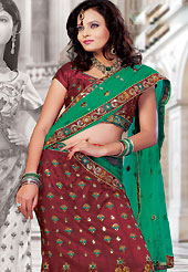 The evolution of style species collection spells pure femininity.  This red net lehenga choli is nicely embroidered and patch work done with resham and sequins work in form of floral motifs. The beautiful embroidery on lehenga made it awesome and gives you stylish and attractive look to others. Matching choli and green dupatta is availble with this lehenga. Slight Color variations are possible due to differing screen and photograph resolutions.