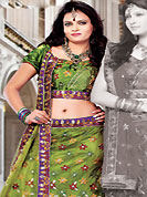 Get ready to sizzle all around you by sparkling lehenga. This olive green net lehenga choli is nicely embroidered and patch work done with resham, zari and sequins work in form of floral motifs. The beautiful embroidery on lehenga made it awesome and gives you stylish and attractive look to others. Matching choli and dupatta is availble with this lehenga. Slight Color variations are possible due to differing screen and photograph resolutions.