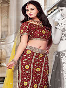 Elegance and innovation of designs crafted for you. This maroon net lehenga choli is nicely embroidered and patch work done with resham, sequins and lace work. The beautiful embroidery on lehenga made it awesome and gives you stylish and attractive look to others. Matching choli and yellow net dupatta is availble with this lehenga. Slight Color variations are possible due to differing screen and photograph resolutions.