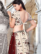 Dreamy variation on shape and forms compliment your style with tradition. This light cream net lehenga choli is nicely embroidered and patch work done with resham, sequins and lace work. The beautiful embroidery on lehenga made it awesome and gives you stylish and attractive look to others. Matching choli and maroon net dupatta is availble with this lehenga. Slight Color variations are possible due to differing screen and photograph resolutions.