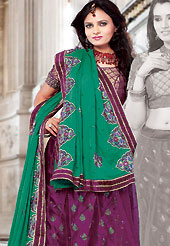 Be the cynosure of all eyes with this wonderful casual wear in flattering colors and combinations. This dark magenta brocade and net lehenga choli is nicely embroidered and patch work done with resham and sequins work. The beautiful embroidery on lehenga made it awesome and gives you stylish and attractive look to others. Matching choli and turquoise green dupatta is availble with this lehenga. Slight Color variations are possible due to differing screen and photograph resolutions.