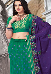Outfit is a novel ways of getting yourself noticed. This green brocade and net lehenga choli is nicely embroidered and patch work done with resham and sequins work. The beautiful embroidery on lehenga made it awesome and gives you stylish and attractive look to others. Matching choli and purple dupatta is availble with this lehenga. Slight Color variations are possible due to differing screen and photograph resolutions.