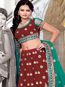 Get ready to sizzle all around you by sparkling lehenga. This red satin lehenga choli is nicely embroidered and patch work done with resham, zari and stone work. The beautiful embroidery on lehenga made it awesome and gives you stylish and attractive look to others. Matching choli and sea green net dupatta is availble with this lehenga. Slight Color variations are possible due to differing screen and photograph resolutions.