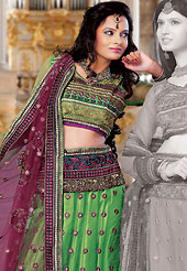 Embroidered lehengas are highly in order on a range of occasions such as wedding, formal party and festivals. This green net lehenga choli is nicely embroidered and patch work done with resham and sequins work. The beautiful embroidery on lehenga made it awesome and gives you stylish and attractive look to others. Matching choli and burgundy net dupatta is availble with this lehenga. Slight Color variations are possible due to differing screen and photograph resolutions.