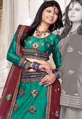 Get ready to sizzle all around you by sparkling lehenga. This turquoise green net lehenga choli is nicely embroidered and patch work done with resham, sequins and lace work in form of floral motifs. The beautiful embroidery on lehenga made it awesome and gives you stylish and attractive look to others. Matching choli and contrasting maroon net dupatta is availble with this lehenga. Slight Color variations are possible due to differing screen and photograph resolutions.