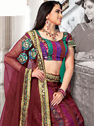 Take a look on the changing fashion of the season. This maroon net and brocade lehenga choli is nicely embroidered and patch work done with resham, sequins and lace work in form of floral motifs. The beautiful embroidery on lehenga made it awesome and gives you stylish and attractive look to others. Matching choli and dupatta is availble with this lehenga. Slight Color variations are possible due to differing screen and photograph resolutions.