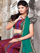 Make your collection more attractive and charming with this impressive dress. This red net and brocade lehenga choli is nicely embroidered and patch work done with resham, stone, sequins and lace work. The beautiful embroidery on lehenga made it awesome and gives you stylish and attractive look to others. Matching choli and contrasting turquoise green net dupatta is availble with this lehenga. Slight Color variations are possible due to differing screen and photograph resolutions.