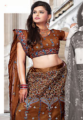 Let your personality speak for you this bridal lehenga embellished with embroidery work. This dark brown net lehenga choli is nicely embroidered and patch work done with resham and sequins work. The beautiful embroidery on lehenga made it awesome and gives you stylish and attractive look to others. Matching choli and dupatta is availble with this lehenga. Slight Color variations are possible due to differing screen and photograph resolutions.
