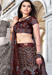 Elegance and innovation of designs crafted for you. This deep brown net lehenga choli is nicely embroidered and patch work done with resham and sequins work. The beautiful embroidery on lehenga made it awesome and gives you stylish and attractive look to others. Matching choli and dupatta is availble with this lehenga. Slight Color variations are possible due to differing screen and photograph resolutions.