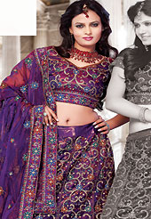 Make your collection more attractive and charming with this impressive dress. This dark purple net lehenga choli is nicely embroidered and patch work done with resham and sequins work. The beautiful embroidery on lehenga made it awesome and gives you stylish and attractive look to others. Matching choli and dupatta is availble with this lehenga. Slight Color variations are possible due to differing screen and photograph resolutions.