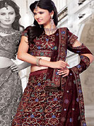 Welcome to the new era of Indian fashion wear. This dark maroon net lehenga choli is nicely embroidered and patch work done with resham and sequins work. The beautiful embroidery on lehenga made it awesome and gives you stylish and attractive look to others. Matching choli and dupatta is availble with this lehenga. Slight Color variations are possible due to differing screen and photograph resolutions.