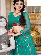 It's cool and has a very modern look to impress all. This teal green net and shimmer lehenga choli is nicely embroidered and patch work done with resham, zari and sequins work. The beautiful embroidery on lehenga made it awesome and gives you stylish and attractive look to others. Matching choli and dupatta is availble with this lehenga. Slight Color variations are possible due to differing screen and photograph resolutions.