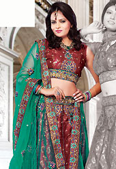 Take a look on the changing fashion of the season. This red brocade and net lehenga choli is nicely embroidered and patch work done with resham and sequins work. The beautiful embroidery on lehenga made it awesome and gives you stylish and attractive look to others. Matching choli and contrasting green net dupatta is availble with this lehenga. Slight Color variations are possible due to differing screen and photograph resolutions.