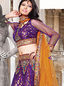 Today's fashion is really about sensuality which can be seen in this creation. This dark purple brocade and net lehenga choli is nicely embroidered and patch work done with resham and sequins work. The beautiful embroidery on lehenga made it awesome and gives you stylish and attractive look to others. Matching choli and contrasting orange net dupatta is availble with this lehenga. Slight Color variations are possible due to differing screen and photograph resolutions.