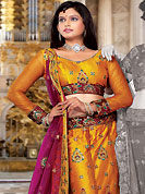 Make your collection more attractive and charming with this impressive dress. This orange net lehenga choli is nicely embroidered and patch work done with resham and sequins work. The beautiful embroidery on lehenga made it awesome and gives you stylish and attractive look to others. Matching choli and contrasting dark magenta net dupatta is availble with this lehenga. Slight Color variations are possible due to differing screen and photograph resolutions.