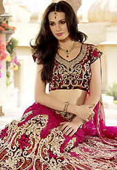Make your collection more attractive and charming with this impressive dress. This dark pink lehenga choli is nicely embroidered and patch work done with resham, zari, sequins, zardosi and stone work in form of floral motifs. The beautiful embroidery on lehenga made it awesome and gives you stylish and attractive look to others. Contrasting maroon embroidery work choli and matching dupatta is availble with this lehenga. Slight Color variations are possible due to differing screen and photograph resolutions.
