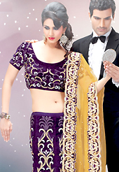 Make your collection more attractive and charming with this impressive dress. This dark purple velvet lehenga choli is nicely embroidered and velvet patch border is done with resham, zari, stone and sequins work. The beautiful embroidery on lehenga made it awesome and gives you stylish and attractive look to others. Matching choli and yellow net dupatta is availble with this lehenga. Slight Color variations are possible due to differing screen and photograph resolutions.