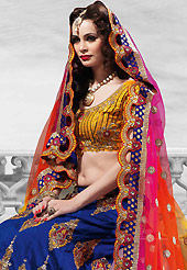 Welcome to the new era of Indian fashion wear. This blue raw silk lehenga is nicely embroidered patch work is done with resham, zari, sequins, stone and kundan work. The beautiful embroidery on lehenga made it awesome and gives you stylish and attractive look to others. Contrasting mustard choli and shaded pink, yellow and orange net dupatta is availble with this lehenga. Slight Color variations are possible due to differing screen and photograph resolutions.