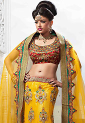 Get ready to sizzle all around you by sparkling lehenga. This yellow net lehenga is nicely embroidered patch work is done with resham, zari, stone, kundan and lace work. The beautiful embroidery on lehenga made it awesome and gives you stylish and attractive look to others. Contrasting red art silk choli and yellow net dupatta is availble with this lehenga. Slight Color variations are possible due to differing screen and photograph resolutions.
