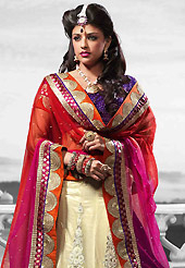 Let your personality speak for you this wedding lehenga embellished with embroidery work. This cream net lehenga is nicely embroidered patch work is done with resham, zari, sequins, stone and lace work. The beautiful embroidery on lehenga made it awesome and gives you stylish and attractive look to others. Contrasting purple choli and shaded red and pink net dupatta is availble with this lehenga. Slight Color variations are possible due to differing screen and photograph resolutions.